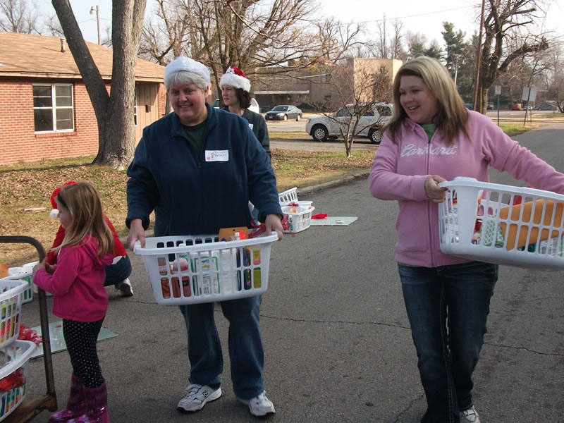 LBFOL volunteers carry baskets for the third round of deliveries at the Wendell Apartments