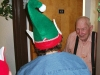 A resident opens his door to a Christmas blessing